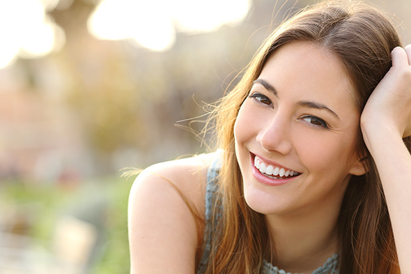 Mulher sorrindoDof Guia Definitivo Sobre Profundidade de Campo Para Iniciantes